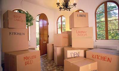 Some packed moving boxes, labelled and ready to load